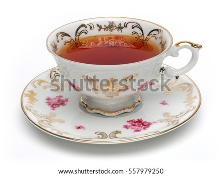 black tea in antique tea cup...
