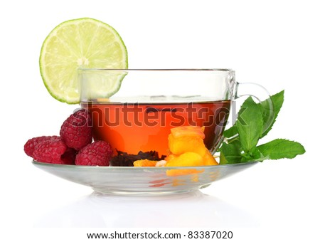 black tea in cup,mint, lime, peach and raspberry isolated on white