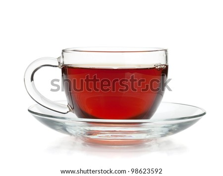 Black tea in glass cup. Isolated on white background