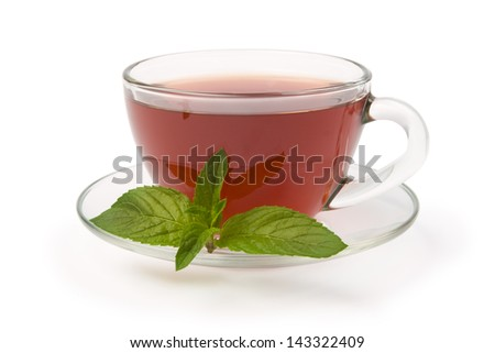 Black tea in glass cup with pepper mint isolated on white background