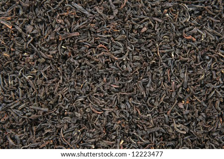 Black tea leaves background. Abstract food textures.