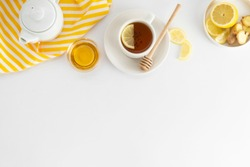 Black tea with lemon and honey on a white background. Hot tea cup isolated, top view flat lay. Flat lay. Autumn, fall or winter drink. Copy space for text.