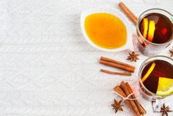 Black tea with lemon, cinnamon and honey. Charming winter background,    with space for text