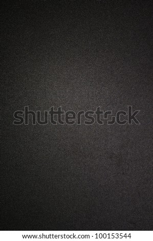 Black texture or background with spotlight - stock photo