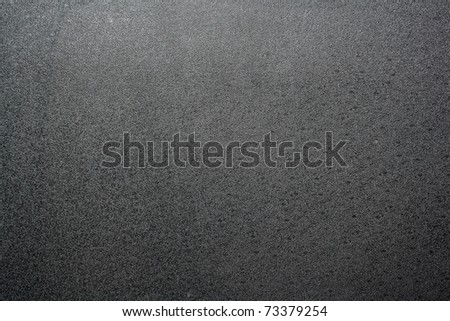 Black texture plastic. closeup Useful as background for design-works.