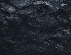 Black texture. Stone black wall. Rock texture. Stone background. Black background. Stone texture. Rock pile background. Rough structure mineral