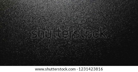 Black textured background, Smooth asphalt road. The texture of the tarmac, top view.