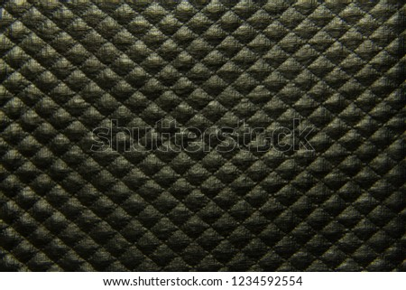 Black textured leather background with rhombuses closeup #1234592554