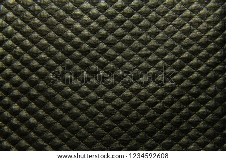 Black textured leather background with rhombuses closeup #1234592608