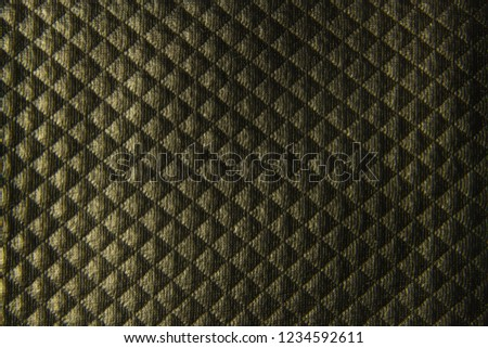 Black textured leather background with rhombuses closeup #1234592611
