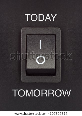 Black toggle switch on black surface - Today Tomorrow