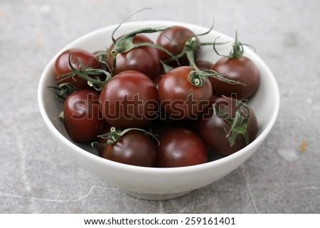 black tomatoes in bowl