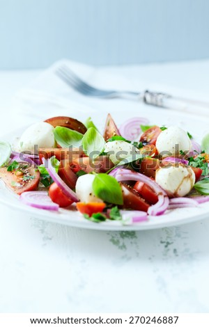 Black Tomatoes with Mozzarella and Fresh Herbs