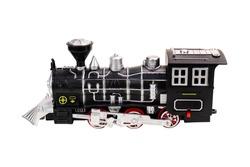Black toy locomotive on a white background, isolated image