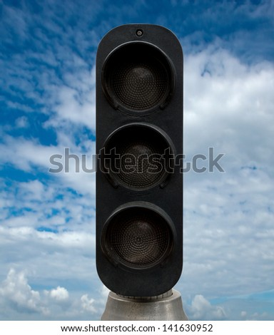 Black traffic lights against blue sky backgrounds. Clipping Path included.