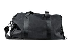 black travel bag isolated on white background. Travel concept