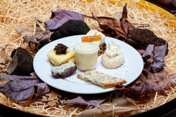 Black truffle entree with cheese and crackers