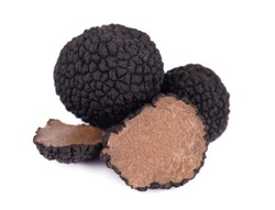 Black truffles isolated on a white background. Fresh sliced truffle. Delicacy exclusive truffle mushroom. Piquant and fragrant French delicacy. Clipping path.