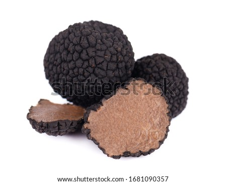 Black truffles isolated on a white background. Fresh sliced truffle. Delicacy exclusive truffle mushroom. Piquant and fragrant French delicacy. Clipping path. Сток-фото ©