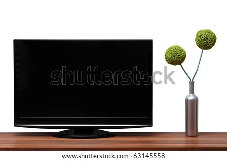 Black TV stands on a wooden shelf