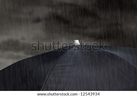 black umbrella with cloudy sky and rain