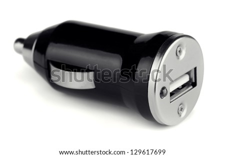Black USB electronics device car charger isolated on white