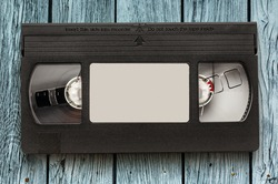 Black video cassette on the wooden background