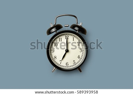 black vintage alarm clock on gray color background