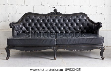 black vintage armchair in white room