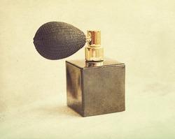 black vintage bottle of perfume, retro
