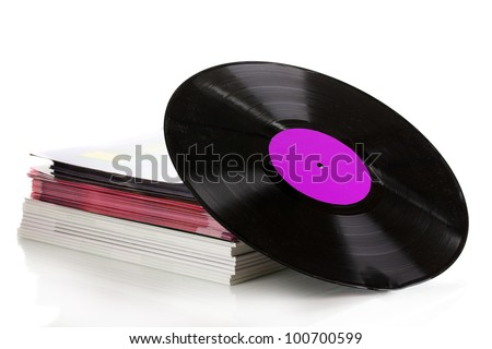 Black vinyl record and stack of magazines isolated on white
