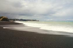 Black volcanic Beach Whirinaki Beach, Hawke's Bay region, Napier, North Island of New Zealand