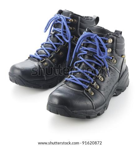 Black walking shoes isolated on white background.