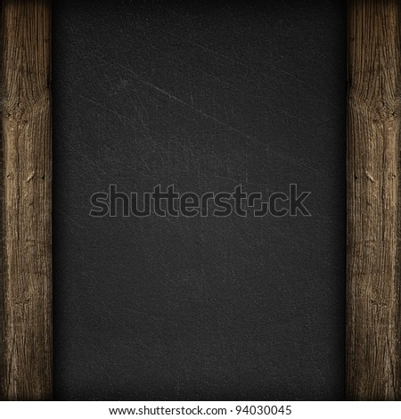 Black wall with wooden panels background or texture