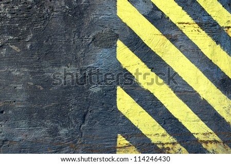 Black wall with yellow paint to draw attention background