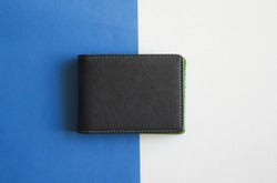 Black wallet isolated on white and blue background . Closed wallet .