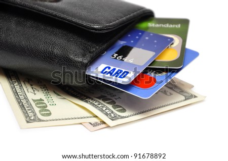 Black Wallet with credit cards and dollar banknotes over white background