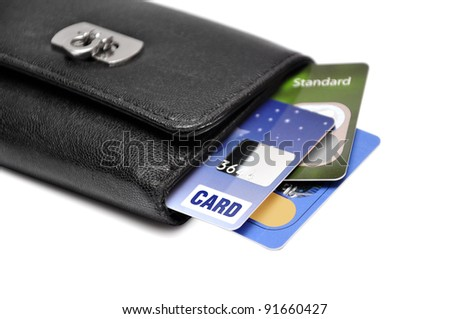 Black Wallet with credit cards over white background