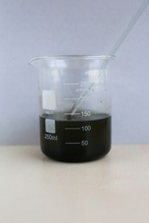 Black water-insoluble substance, copper sulfide, in the form of a colloidal precipitate, in a beaker.