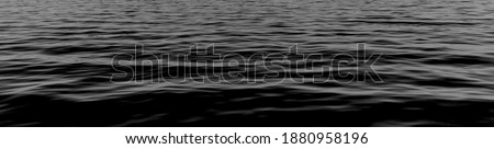 black water sea wave. black water surface dark nature background. Black river waves texture. ripple effect on surface sea water in black and white color.