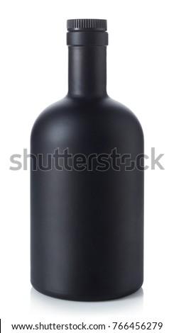 Black whiskey bottle isolated on white background