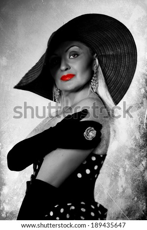Black, white and red closeup fashion portrait of glamour woman\'s face with red lips and creative  hairstyle.