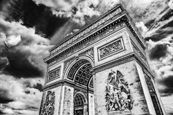 Black White Arc de Triomphe Place Charles de Gaulle Paris France.  Up to Champs Elysees, site of French Unkown soldier. Honors those who fought in Revolutionary Napoleonic and other wars.
