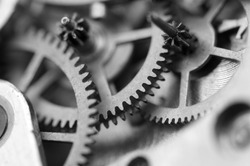 Black white background with metal cogwheels a clockwork. Conceptual photo for your successful business design. Macro.
