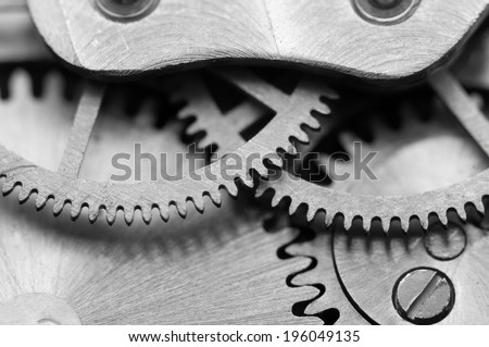 Black white background with metal cogwheels a clockwork Macro