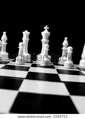 black & white chess pieces, tilted vertical