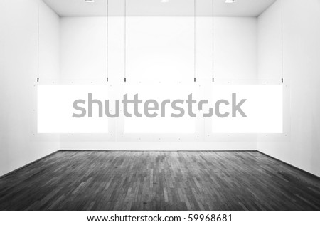 Black & white exhibition room with three pictures and white background