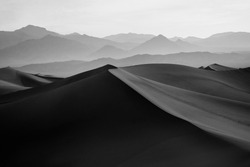 Black & White Image of Mesquite Flat Sand Dunes and Desert with Mountains in the Distance, located in Death Valley National Park in California
