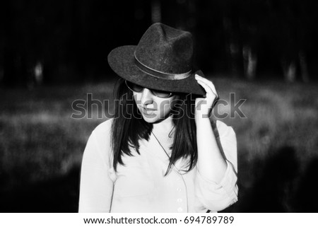 Black white photo of a girl in a hat #694789789