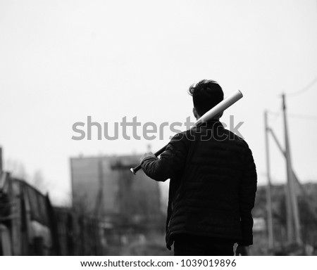 Black White photo of Asian young man outdoors posing at camera - Shutterstock ID 1039019896
